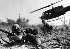 Ia Drang - Bruce P. Crandall's UH-1 Huey helicopter and U.S. Air Cavalrymen under fire at LZ X-Ray.