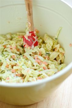 Coleslaw-  1/2 head green cabbage, shredded  1/2 onion, finely diced  1 large carrot, grated  2 tablespoons chopped chives {optional}  1 cup mayonnaise  1/4 cup white vinegar  3 tablespoons sugar  salt & pepper, to taste