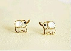 FASHION OPAL ELEPHANT STUD EARRINGS even though i'm not going to get a standard lobe piercing, i think that they have such cute earrings