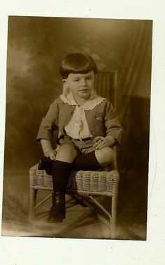 G33 Vintage photo sepia tone, cute little boy in button shoes
