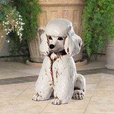 """Poodle dog statue 12 inches high.  Beautiful ceramic sculpture hand made in Italy by skilled artisans.  Rich in detail and colors.  Patterns and colors may vary slightly.  Ships FREE in continental USA Dimensions:  12""""H Material:  Fine Italian Ceramic Shipping Dimensions: 15""""L 15""""W 15""""H Recommended for Indoor use Made in Italy Item # 11052 Price: $169.00 Questions? Call (888) 775-0010"""