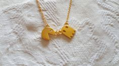 Cute little gold necklace with a pac-man charm at the bottom for all those gamers :)