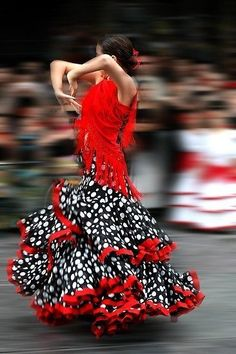 I love this, if for the dress only...Scarlett is the nearest color to describing the exuberance and vitality of the human heart. Is that why hearts are so often red? Look at this women sway so confidently, as her skirt expands around her body. One day, that's for me; I have it on my to-do list.