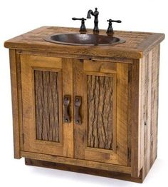 Custom vanities are a Woodland Creek Furniture specialty.  This barnwood vanity design can be made any size or layout needed.  This design is different from our other barnwood vanities due to the wildwood door panels.  The wood is actually harvested tree bark.  We have found a way to stabilize actual tree bark and use it