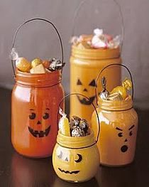 Cute Halloween Decoration with old jars (spaghetti jar, baby food jar, etc.). Paint in different shades of orange and use Sharpie to create jack-o-lantern face.