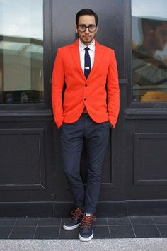 Shop this look for $243:  http://lookastic.com/men/looks/blazer-and-dress-shirt-and-tie-and-chinos-and-boots/1175  — Orange Blazer  — White Dress Shirt  — Navy Tie  — Navy Chinos  — Navy Leather Boots