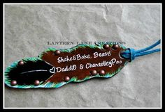 Custom painted and personalized saddle feather