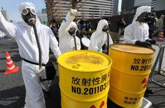 Thousands turn out for anti-nuclear rally in Tokyo. People in protective suits and masks shout slogans next to mock drums of nuclear waste from the Fukushima No. 1 power plant during a march denouncing nuclear power in Tokyo on Sunday.