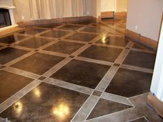 What a great idea... this floor is a concrete slab... acid stained.  They used just brown stain, the lighter areas used diluted stain. Stain Concrete, Painted Cement Floors, Painting Cement, Concrete Patio, Stenciled Concrete Floor, Acid Stained Concrete Floors, Concrete Color, Concrete Finishes, Decorative Concrete