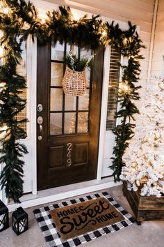 Inspiring Diy Christmas Door Decorations Ideas For Home And School 04 Diy Christmas Door Decorations, Decorating Porch For Christmas, Outdoor Christmas Garland, Winter Porch Decorations, Porch Garland, Christmas Window Boxes, Christmas Front Doors, Farmhouse Christmas Decor, Christmas Wreath On Windows
