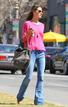 Alessandra Ambrosio showed off her stems in a bohemian-print Ella Moss mini and Rag & Bone boots. : During a sunny day in LA, Alessandra Ambrosio showed off her bright side in a hot-pink sweater, which she paired with wide-legged jeans and a gray Givenchy bag.