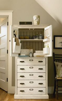 Clayton Cabinet in Porch Swing   love the vintage hardware look