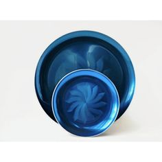 Olden Design of Norway Anodized Aluminum Pinwheel Plates, Vibrant... (€35) ❤ liked on Polyvore featuring home and kitchen & dining