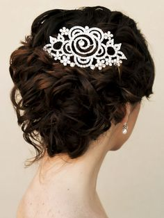 Large rhinestone flower hair comb in a curly bridal updo hairstyle by Hair Comes the Bride.