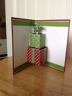 Stampin Up pop up Christmas card inside with present.