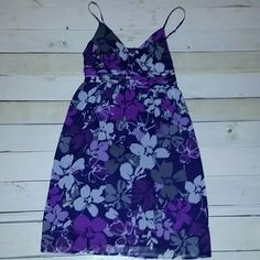 Elle Camisole dress Pretty purple flowered dress by elle. Would fit a XS or S best. Worn only twice, perfect for a date night or summer wedding. Has a side zipper closure for easy on and off. Comes from a smoke free home. Elle Dresses