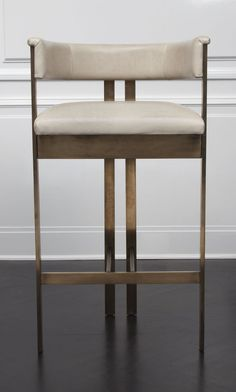 "KELLY WEARSTLER | ELLIOTT BAR STOOL. Crafted in leather and 1/2"" solid brass stock"