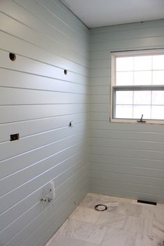 Love the wall of plank boards, different spin on bead board, and the color is gorgeous! (Benjamin Moore Paladian Blue)