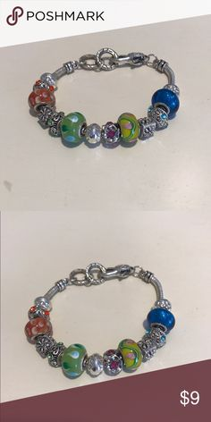 Charm bracelet Charm bracelet. Perfect to wear alone and stack. Beautiful colors! Jewelry Bracelets