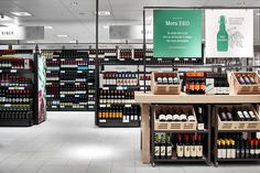 Discover ideas about wine shop interior Wine Shop Interior, Retail Interior, Store Signage, Retail Signage, Food Retail, Retail Shop, Pharmacy Design, Retail Design, Alcohol Shop
