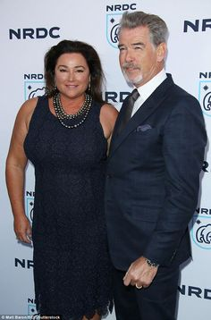 Cute couple: Pierce Brosnan and wife of 15 years Keely Shaye Smith cuddled up on the red carpet at Los Angeles event
