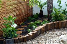 vertical logs as retaining wall garden pinterest. Black Bedroom Furniture Sets. Home Design Ideas