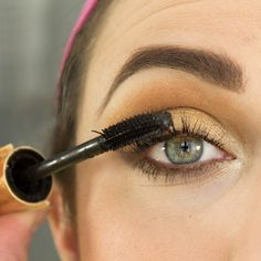 Metallic gold eye makeup is a popular spring look. Our easy step-by-step tutorial shows you how to achieve this stunning look at home. #makeup #spring #runway