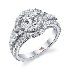 DemarcoJewelry.com  Available in White Gold 18KT and Platinum. 1.30 RD 0.35 BGCapture her grace and endless beauty with this confident yet elegant design. We have also incorporated a unique pink diamond with every single one of our rings, symbolizing that hidden, unspoken emotion and feeling one carries in their heart about their significant other. This isn\'t just another ring, this is a heirloom piece of jewelry.   Demarco Bridal Engagement Ring.