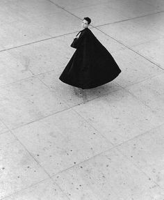 Tina Chow in a 1951 black silk faille evening coat by Balenciaga, photographed by David Seidner.