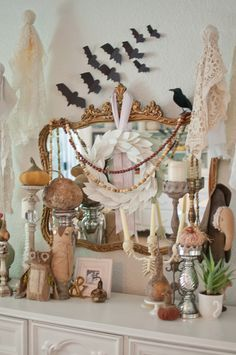 Take a feminine approach to Halloween by incorporating lace, adorable woodland creatures, and hints of pink into your mantel decor.