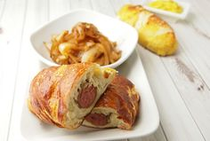 Pretzel Wrapped Brats with Cider Braised Onions.