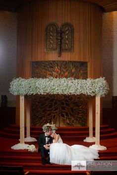 Raw wooden post and Baby's Breath chuppah.   Photo credit to Creation Studios