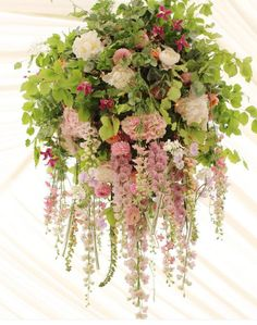 Three Circular Chandeliers Of Smilax Vine And Italian Ruscus - Beautiful diy white flowers chandelier