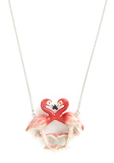 Dangling from a long silver chain, this porcelain pendant shows a crimson-pink and ivory pair forming a heart as their beaks greet each other in a cute birdie smooch.