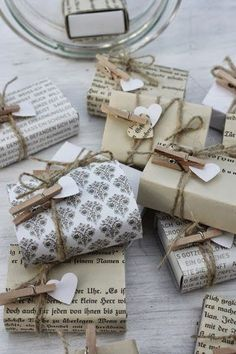 I am liking the use of clothesline pins for holding gift tags.