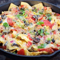 These Pizza Nachos make a great camping recipe. The loaded toppings and garlic cream sauce are part of what makes this so delicious.