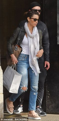 Urban chic: Jessica opted for the urban chic look with distressed blue jeans, scarf and platform sneakers