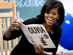 First Lady Michelle Obama reading to children.