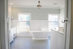 Light & airy master bathroom. Paint color is Sea Salt by Sherwin Williams.