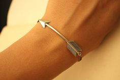Silver arrow bracelet.  A must have.