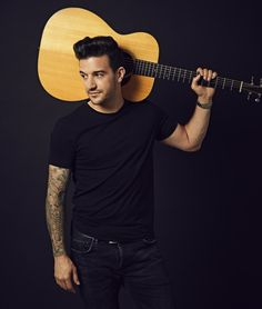 mark ballas holds guitar in promo pic