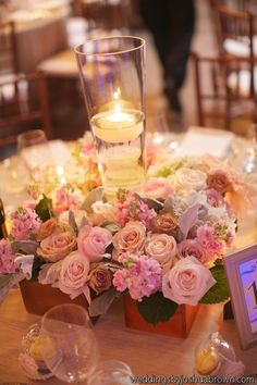 I like the idea of a low flower arrangement so that people are having to duck behind the flowers to see each other over dinner. :)