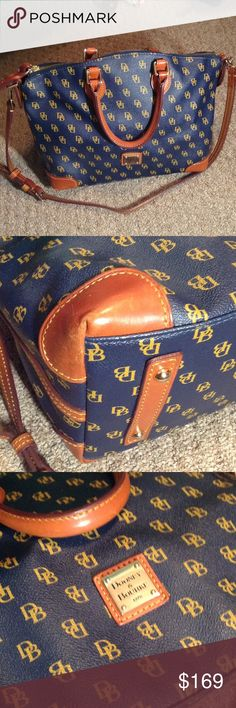 Beautiful Navy Dooney & Bourke Logo Purse Nice medium to large satchel purse for work or trip to the grocery store! In great condition, four corners are worn, one photographed is the worst. At the end of the zipper the leather has something on it that may come off if cleaned properly. Has registration card to DB, not filled out inside!  Open to reasonable offers! Dooney & Bourke Bags Satchels