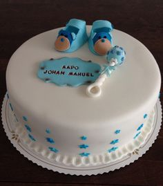 Christening cake for boy. Decorations are all fondant: baby shoes, rattle and nameplate