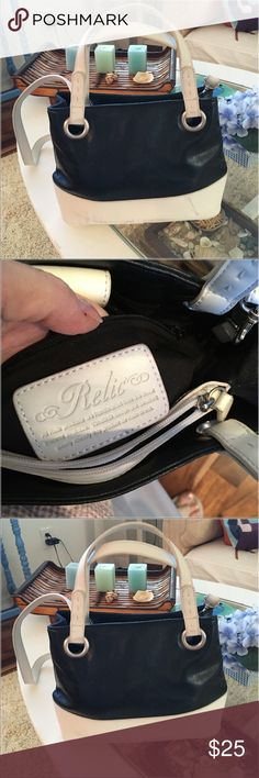 "Relic Crossbody strap purse Cute soft leather , black and white has snap closure silver hardware has 3 inside sections  one slip pocket for cell phone dimensions are 13"" across eight "" deep41/2 flat bottom relic Bags Crossbody Bags"