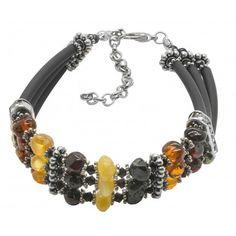 Bracelet style Grèce antique avec des perles d'ambre multicolre de couleur miel, cognac et citron. Un bracelet qui sort de l'ordinaire. Largeur approximative: 1.5 cm Circonférence: 17 cm (+4cm ajustable) Poids approximatif: 12.9 grammes