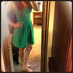 Banana Republic strapless dress Medium green with rich stitching and zip up back. Only worn once. Side pockets. Length: 30 in from top to bottom. Banana Republic Dresses Strapless