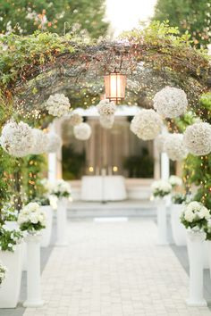 An aisle of white rose petals and branches dripping with crystals 20 wedding ceremony ideas that will take your breath away junglespirit Gallery