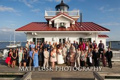 A group photo is a fun way to preserve memories of all your guests.  Photo by Matt Lusk Photography www.engagingeventsobx.com  #engagingeventsobx  #outerbankswedding