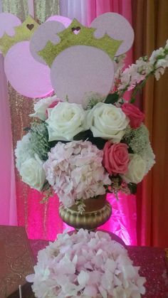 Flower arrangements at a royal Minnie Mouse birthday party! See more party planning ideas at CatchMyParty.com!